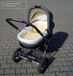 a babybuggy with a lambskin-cushion